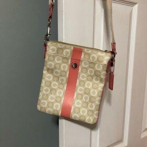 Coral and cream Coach purse